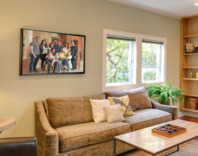 family painting from photo displayed on wall